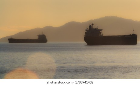 Cargo ferries during sunset by English Bay Vancouver, Canada