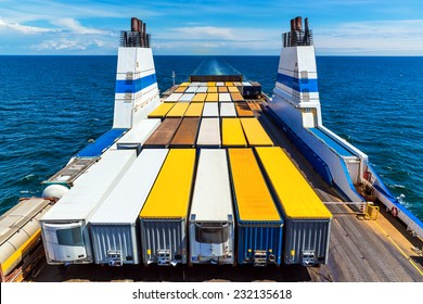 Cargo ferry commercial industrial ship with truck freight containers in the sea