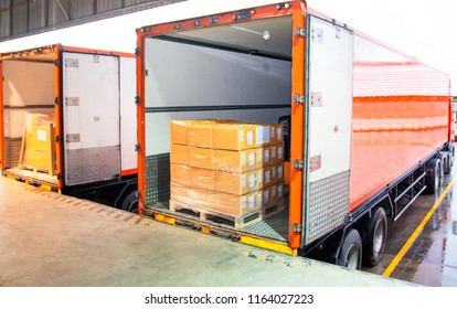 Cargo freight truck. Shipment, Delivery service. Logistics and transportation. Warehouse dock load pallet goods into shipping container truck. Stacked package boxes on pallet inside a truck.