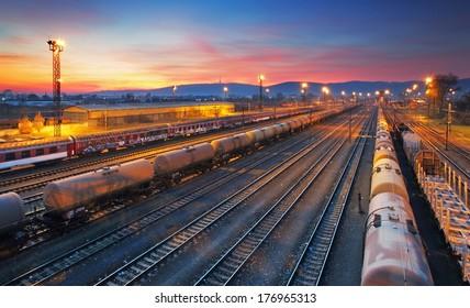 Cargo freigt train railroad station at dusk