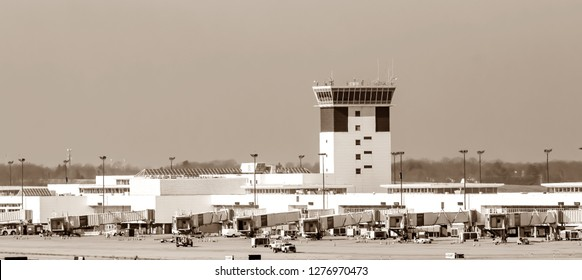 Cargo international airport loading area with trucks and workers on ground and control tower