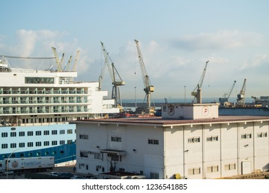 Cargo port cranes, ship and transport terminal at the port of Palermo, Sicily, Italy, 8 October 2018.