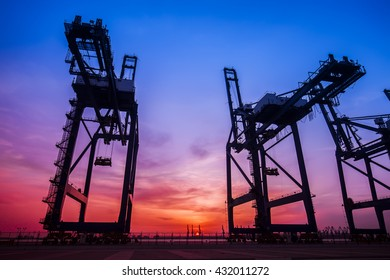 Cargo port in the evening,The silhouette of gantry crane