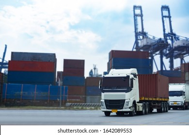 Cargo Red Container truck in ship port Logistics.Transportation industry in port business concept.import,export logistic industrial Transporting Land transport on Port transportation storge