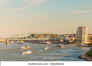 Cargo riverboats passing the Dutch city of Nijmegen in the afternoon