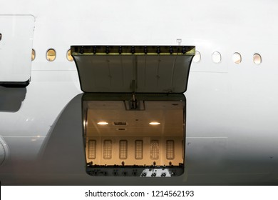 cargo section in the airplane open on inspection, with bags and luggage of passengers