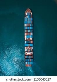 A cargo ship from aerial view taken by Drone.  Cargo ship is a ship or vessel that carries cargo, goods, and materials from one port to another.
