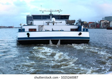 Cargo ship or cargo boat in Amsterdam harbor, the Netherlands