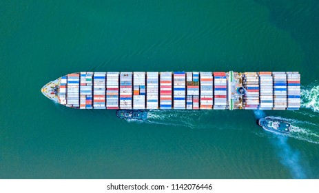 Cargo ship carries the container heading to the port where is many cranes at the edge. It is the important part of imported and exported economy. Singapore