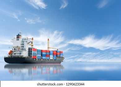 Cargo ship carrying container and running for export  goods  from  cargo yard port to other ocean concept freight shipping ship on blue sky background.