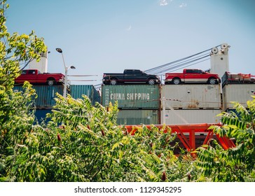 """A cargo ship carrying containers with the label """"China Shipping"""" passes through a canal lock in Ste. Catherine, Quebec, Canada on Saturday, July 7, 2018."""