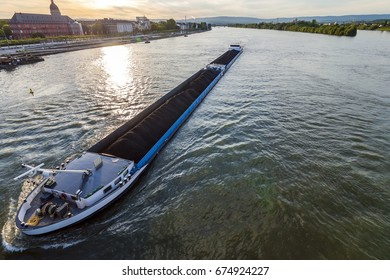 Cargo ship with coal bulk load on the river Rhine in Mainz, Germany
