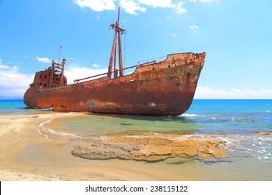 Cargo ship covered with rust on a beach near Gythio, Greece