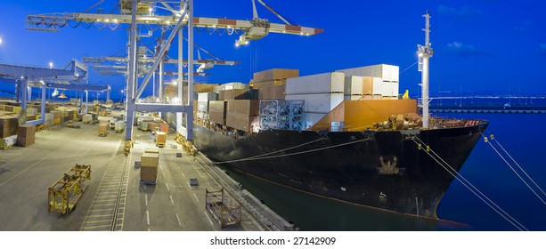 cargo ship at dock by night panorama
