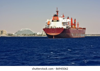 Cargo ship entering the harbor at the Red Sea