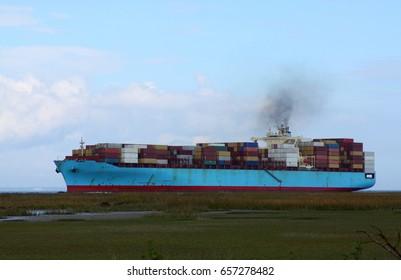 Cargo ship entering port in Savannah Georgia.