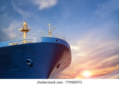 cargo ship forward close up on blue sky background