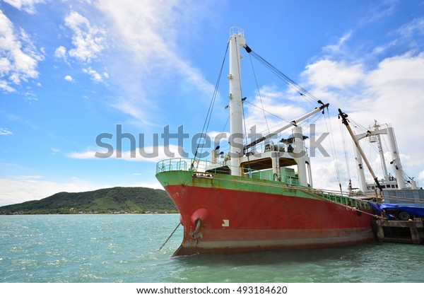 Cargo Ship frighter boat  in the harbor and a Blue Sky, Songkhla lake