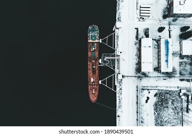 Cargo ship in the harbor at winter.