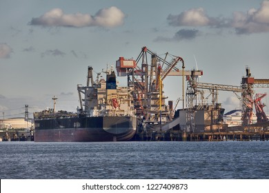 Cargo ship in an industrial dock