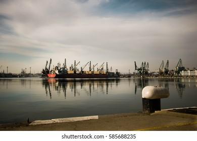 Cargo ship into harbor,shipyards