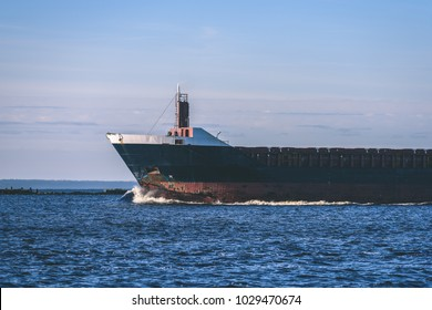 cargo ship is leaving port sailing away. riga. latvia - vintage retro look
