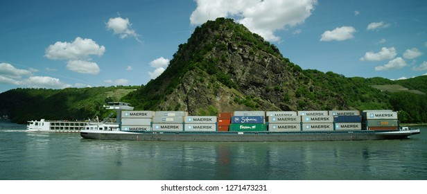 Cargo ship. Loreley Rock at the Rhine River  with the City St. Goar in the background, region Rhineland-Palatinate, Germany St. Goar, Central Europe, july 2017