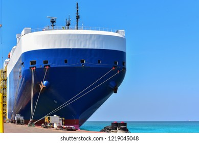 Cargo ship Moored and Mooring bollard with a fixed rope on the front of Bulbous bow ship Logistics and Transportation of international Container Cargo ship in the sea on blue sky