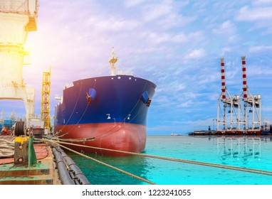 Cargo ship Moored in Port, Logistics import export background of container Cargo ship in seaport on blue sky, freight Transportation