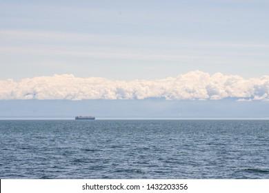 Cargo Ship Mountains Ocean Horizon