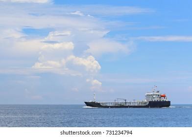 Cargo ship on the sea with beautiful sky.
