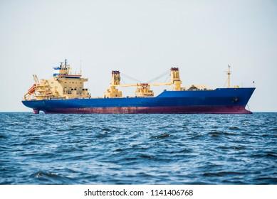 Cargo ship in the open Baltic sea on a cloudy day, Latvia