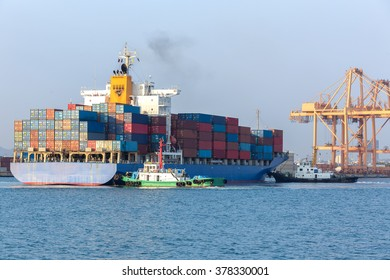 Cargo ship at the port arriving with push boat working