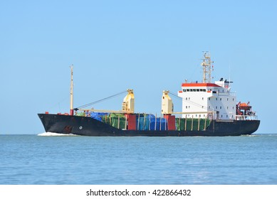 Cargo ship sailing in blue sea to the port of Antwerpen, Belgium