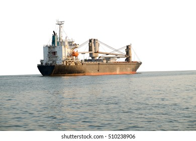 Cargo ship sailing in still water on white background