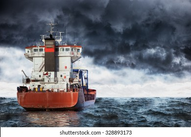 Cargo ship at sea during a storm.