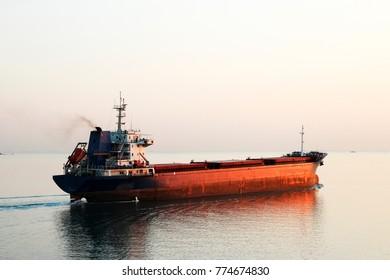 cargo ship straight to dawn horizon