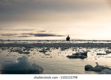 Cargo ship surrounded by floating ice, Spitsbergen