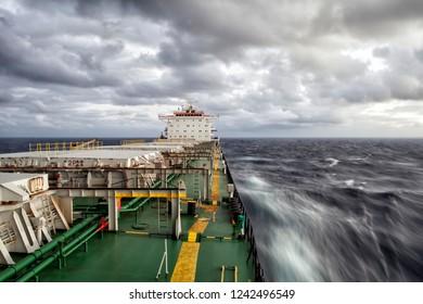 Cargo ship underway. Motion effect
