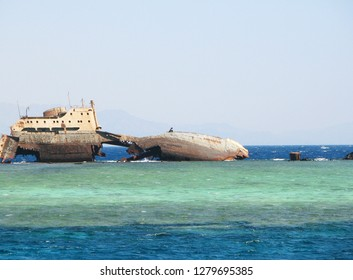 Cargo ship wreck on sandbank in the red sea