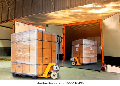 Cargo shipment loading for truck. Freight truck for delivery service. Logistics and transportation. Warehouse dock load pallet goods into container truck. Stacked boxes on plastic pallet with truck.