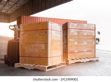 Cargo shipment loading for truck. Freight trailer truck for delivery service. Warehouse dock load cargo into shipping container. Stacked boxes wrapped plastic on pallet rack. Logistics cargo transport