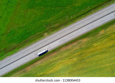 Cargo shipping theme. Lorry on highway view from above.