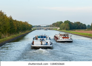 Cargo ships overtake on the lock canal of the Weser near Balge