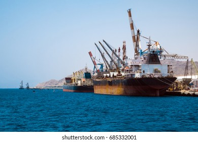 Cargo ships stand in the port of Eilat on the Red Sea (Israel)