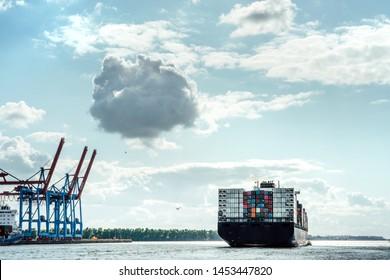 Cargo ships at the terminal in Hamburg, Germany