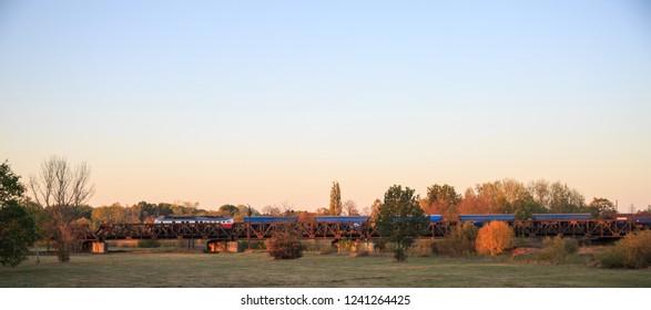 Cargo train on a metal bridge