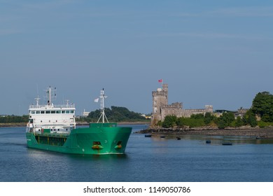 Cargo vessel pass the famous Blackrock castle in Ireland.
