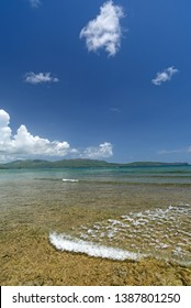 Caribbean bay on Samana peninsula with blue sky and some white clouds in it