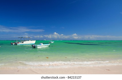 Caribbean beach with boats, Dominican Republic